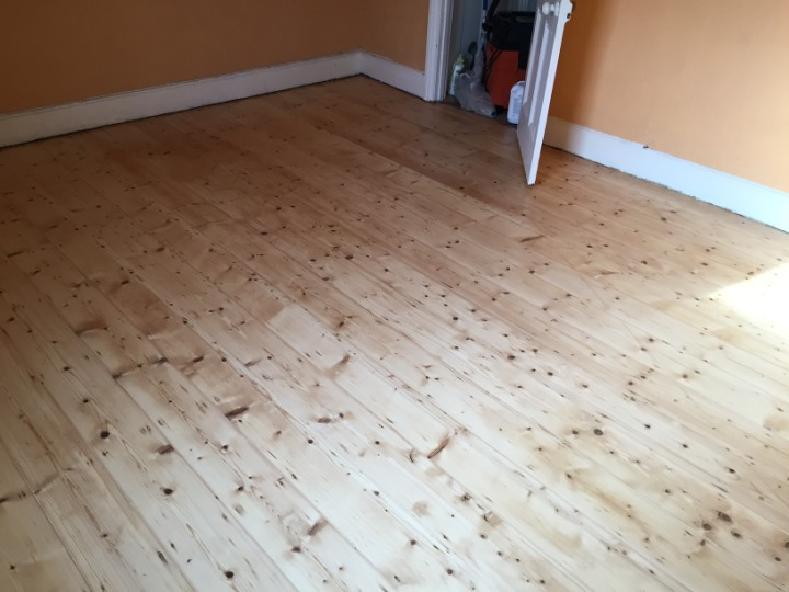 a stripped sanded restored floor